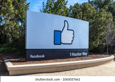 Menlo Park, California, USA - March 29, 2018: Sign of Facebook at the entrance of the headquarter in Silicon Valley. Facebook is an American online social media and social networking service company.
