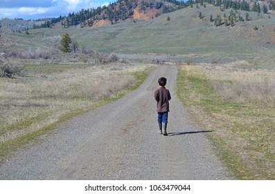 Mennonite Boy Walking Down Country Road Alone