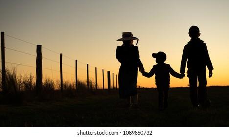 Mennonite family and children holding hands