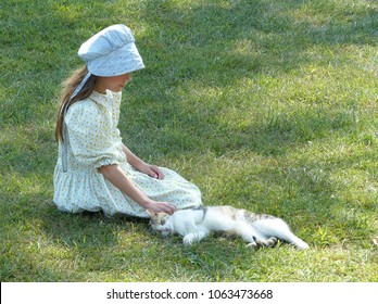 Mennonite Girl Petting Kitten on Amish Farm