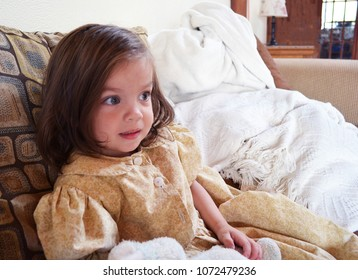 Mennonite Girl Sitting on Couch