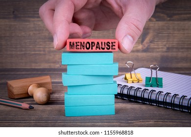 Menopause, women's health concept With Colorful Wooden Blocks