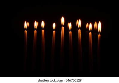 Menorah with All Candles Lit on Black