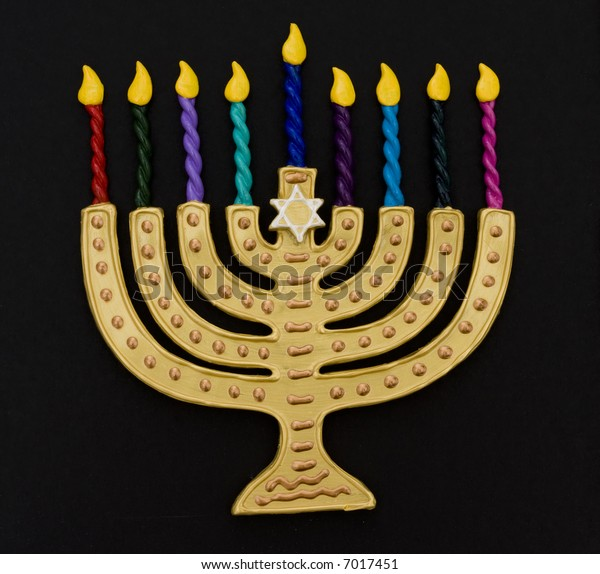Menorah with colorful candles on a black background