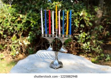 Menorah for Hanukkah in the form of a Jewish star (Magen David) and Wood Dreidels (Toy). Hanukkah, Jewish Holiday. Symbols of Hanukkah and Judaism. Image for Jewish Holiday Hanukkah. Israel
