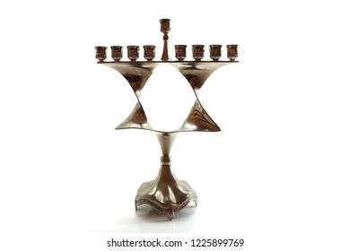 Menorah for Hanukkah in the form of a Jewish star (Magen David). Jewish Holiday. Symbol of Hanukkah, Judaism. Image for Jewish Holiday Hanukkah, Israel. Menorah isolated on white background