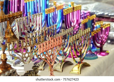 Menorah of Hanukkah (traditional candelabra) at the stand of souvenir and gift present shop, Netanya, Israel. Jewish traditions and holidays.