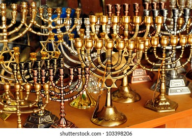 Menorah for sale in shop in the Jerusalem old city market. Hanukkah Jewish holiday is observed for eight nights and days.