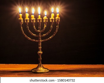 Menorah with seven burning candles.