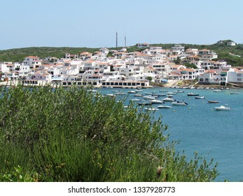 Menorca, Spain - July, 10th 2018: picture of the coast of the beautiful Menorca island in Spain. the mix of the green and blue colours of water and land create a beautiful natural effect.