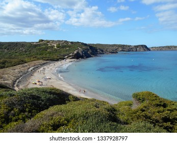 Menorca, Spain - July, 10th 2018: picture of Cala Tortuga in the beautiful Menorca island in Spain. the mix of the green and blue colours of water and land create a beautiful natural effect.