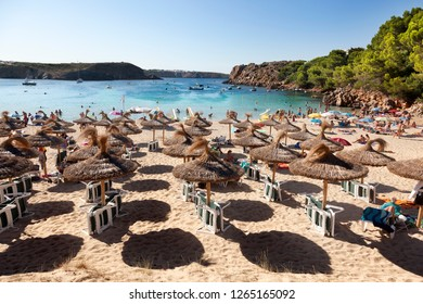 MENORCA, SPAIN-AUGUST 27, 2015: Panoramic views of a beach full of people and Sunshades in summer in Menorca, Spain on August, 27, 2015