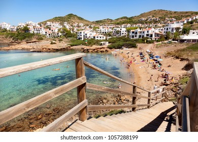 MENORCA, SPAIN-AUGUST 27, 2015: Views of a beach full of people on August 27, 2015 in Fornells beach, Menorca