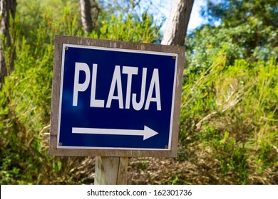 Menorca track blue sign with Platja or beach arrow in Mediterranean pine forest