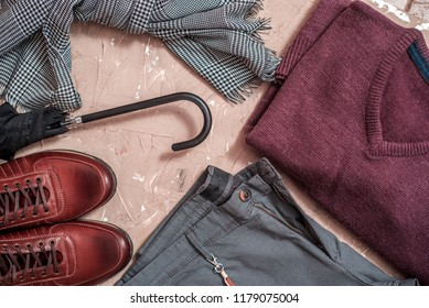 Men's accessories, belt and umbrella. Set of classic men's clothing - blue pants, a shirt and a purple pullover. leather brown shoes and a lot of money. concept of a successful rich man .