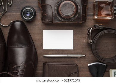 men's accessories and blank business card mockup on the brown wooden table
