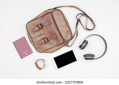 Men's accessories, essential travel items on white rustic wooden background