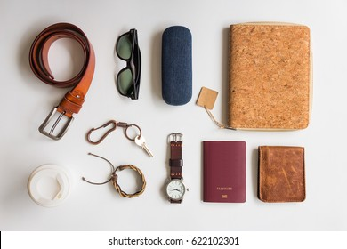 Men's accessories and essential travel items on white background, flat lay fashion and beauty concept