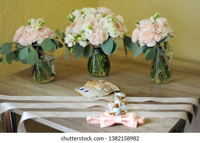 Men's accessories for groom, money, flawers and bow tie on the table