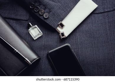 Men's accessories - smartphone, cufflinks, shirt, pen, jacket.