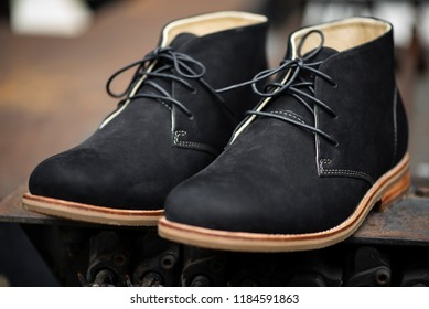 Men's ankle boot with black nubuck leather, selective focus ,closed up