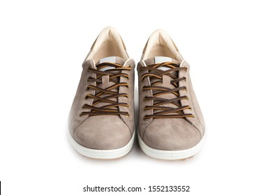 Men's beige nubuck leather sneakers isolated on white background, leather lace, fabric lining and light platform soles for maximum comfort