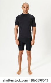 Men's black short sleeved wetsuit top full body shot