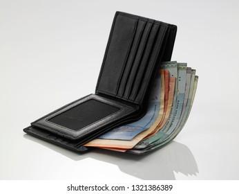 men's black wallet money in cash wooden white  background