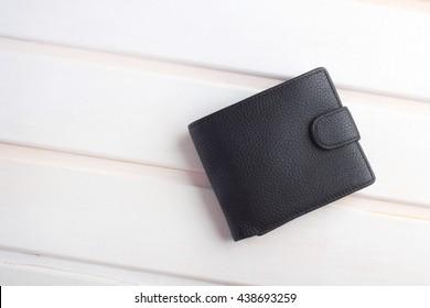 men's black wallet money in cash wooden white vintage background