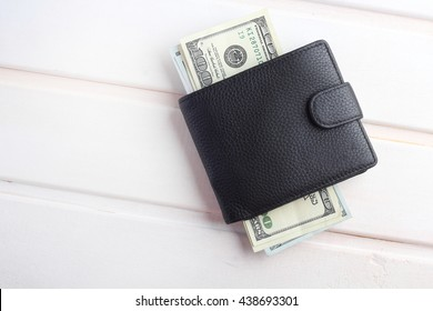 men's black wallet money in cash wooden white vintage background