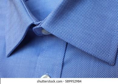 Men's blue cotton shirt close up.