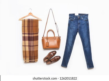 Men's blue jeans and handbag with scarf ,leather shoes on a white background