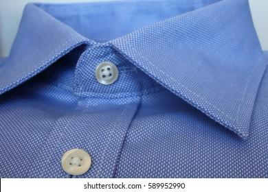 Men's blue pure cotton shirt close up.