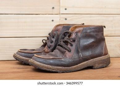 Men's boot fashion on wooden floor