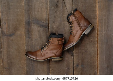 men's boots shoes on a wooden background.