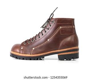 Men's brown boot isolated on a white background.