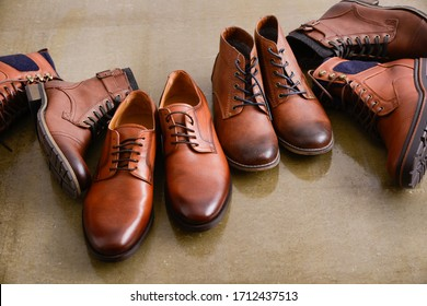 men's brown ,boots, shoes and Leather shoes on gray background
