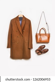Men's brown coat on hanging with leather bag ,leather shoes