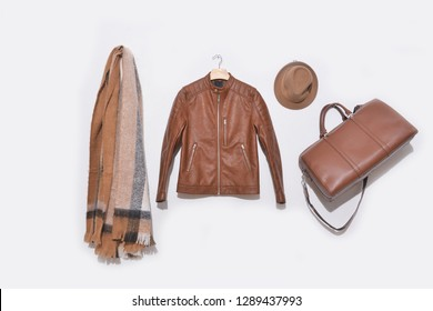 Men's brown jacket clothes with scarf ,handbag, hat on white background