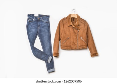 Men's brown jacket on hanging with blue jeans