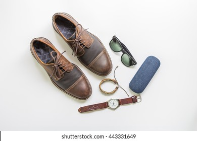 Men's brown leather shoes with accessories, flat lay, top view copy space background