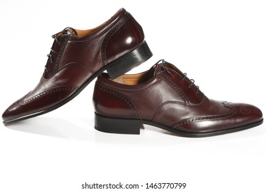 men's brown shoes on a white background