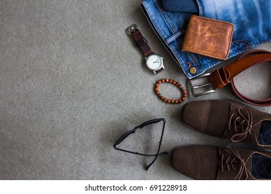 Men's casual clothes outfits with jeans, leather shoes and accessories with space on gray background