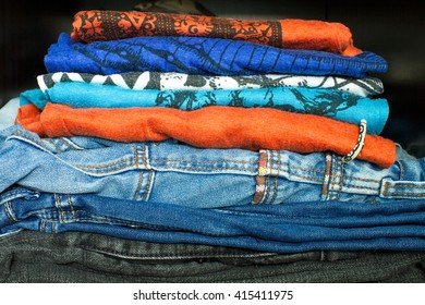 Men's casual dress of colorful shirts, are piled up on top of denim shorts and pants. Wearing these colorful clothes can make the day cheerful.