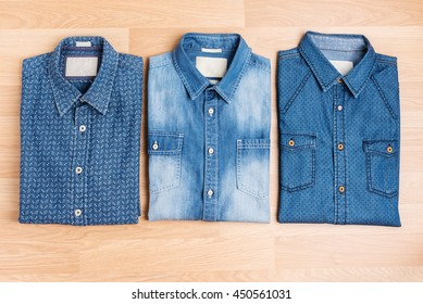Men's casual jeans shirt trendy fashion on wooden table top view, still life style