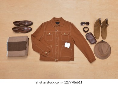 Men's casual outfit. Men's clothing and accessories on wooden background, flat lay
