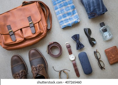 Men's casual outfits with accessories on gray grunge background