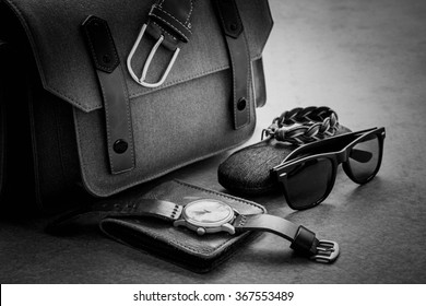 Men's casual outfits with camera bag and accessories on gray grunge background