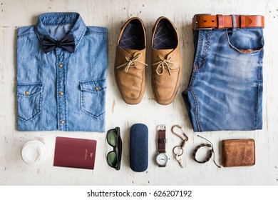 Men's casual outfits with fashionable jeans clothing on white rustic wooden board background, flat lay fashion and beauty concept