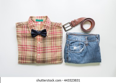 Men's casual outfits with jeans and brown plaid shirt, flat lay, top view background